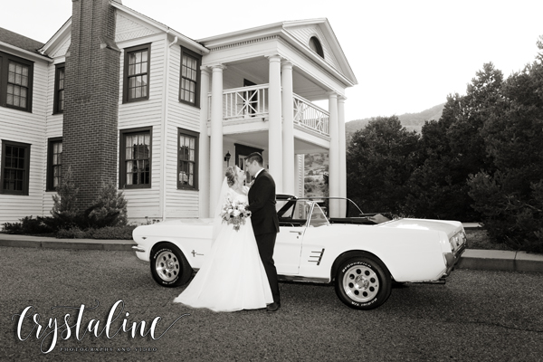 Willow Ridge Manor - Bride and groom with Mustang